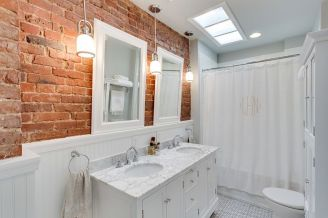 Cozy bathroom update adapting brick wall accents showing charm and friendly finish Image 10