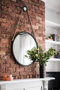 Cozy bathroom update adapting brick wall accents showing charm and friendly finish Image 16