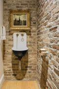 Cozy bathroom update adapting brick wall accents showing charm and friendly finish Image 18