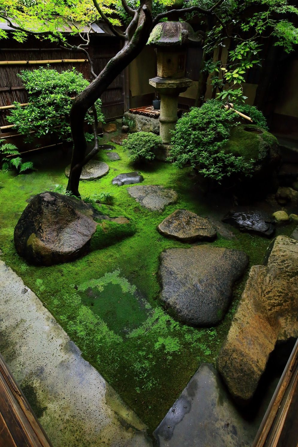 Green outdoor ideas with calming vibes from Zen garden style showing harmonious and balanced various natural elements Image 40