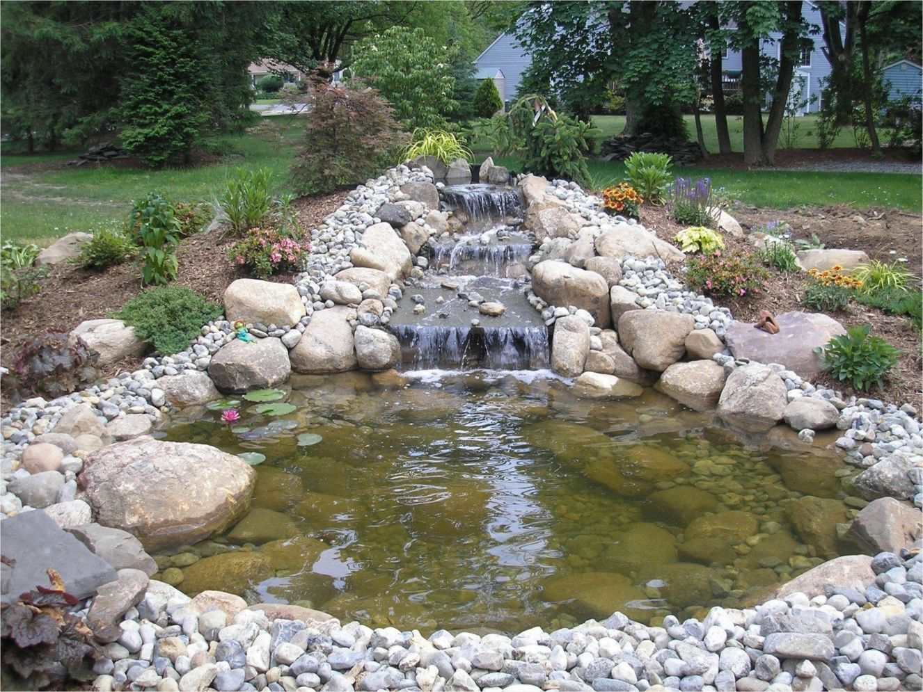 Inspiring small fish pond designs to upgrade the outdoor landscape for more lively and refreshing Image 30