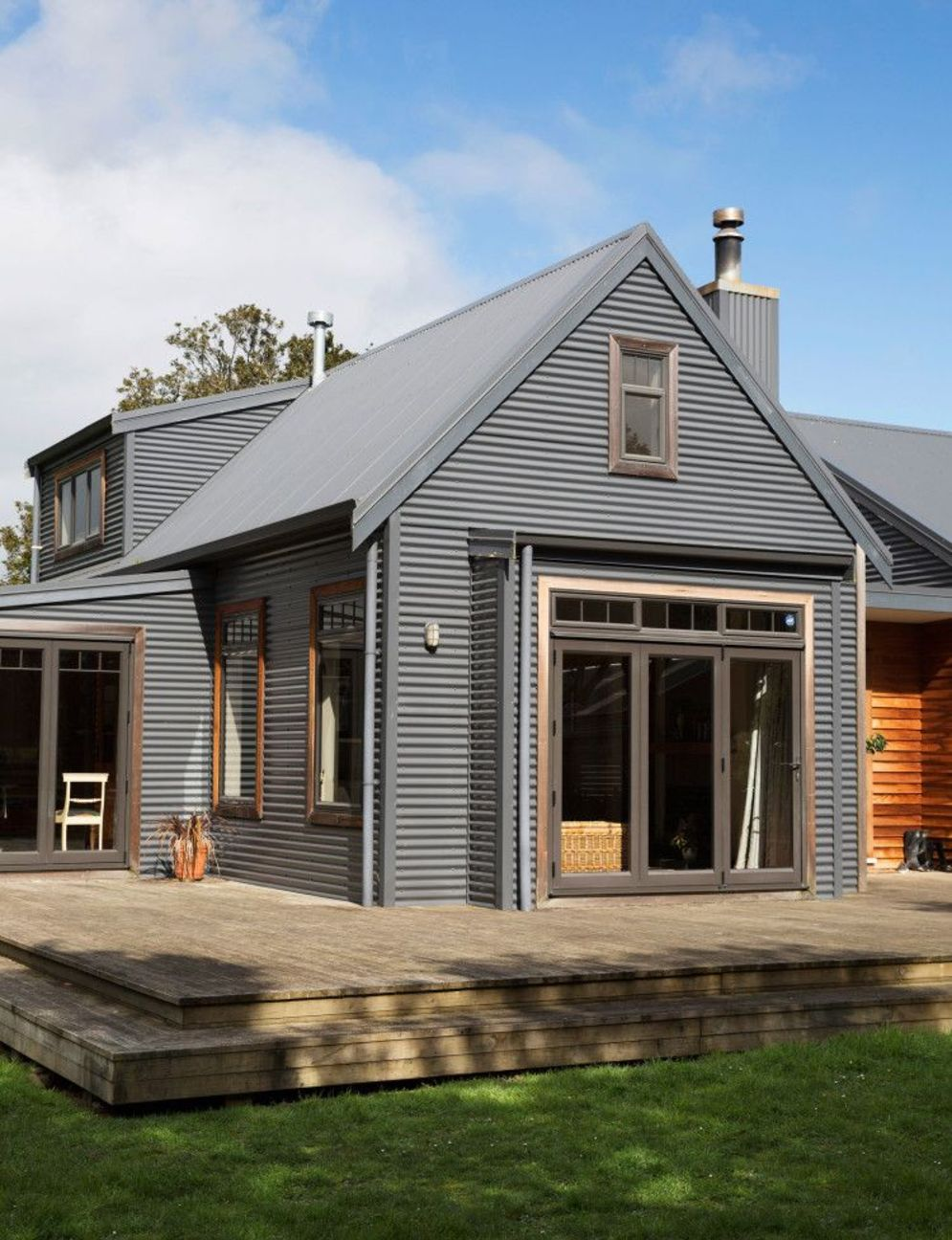 Modern house with new farmhouse exterior design pulling out country charm and warm welcoming display Image 32