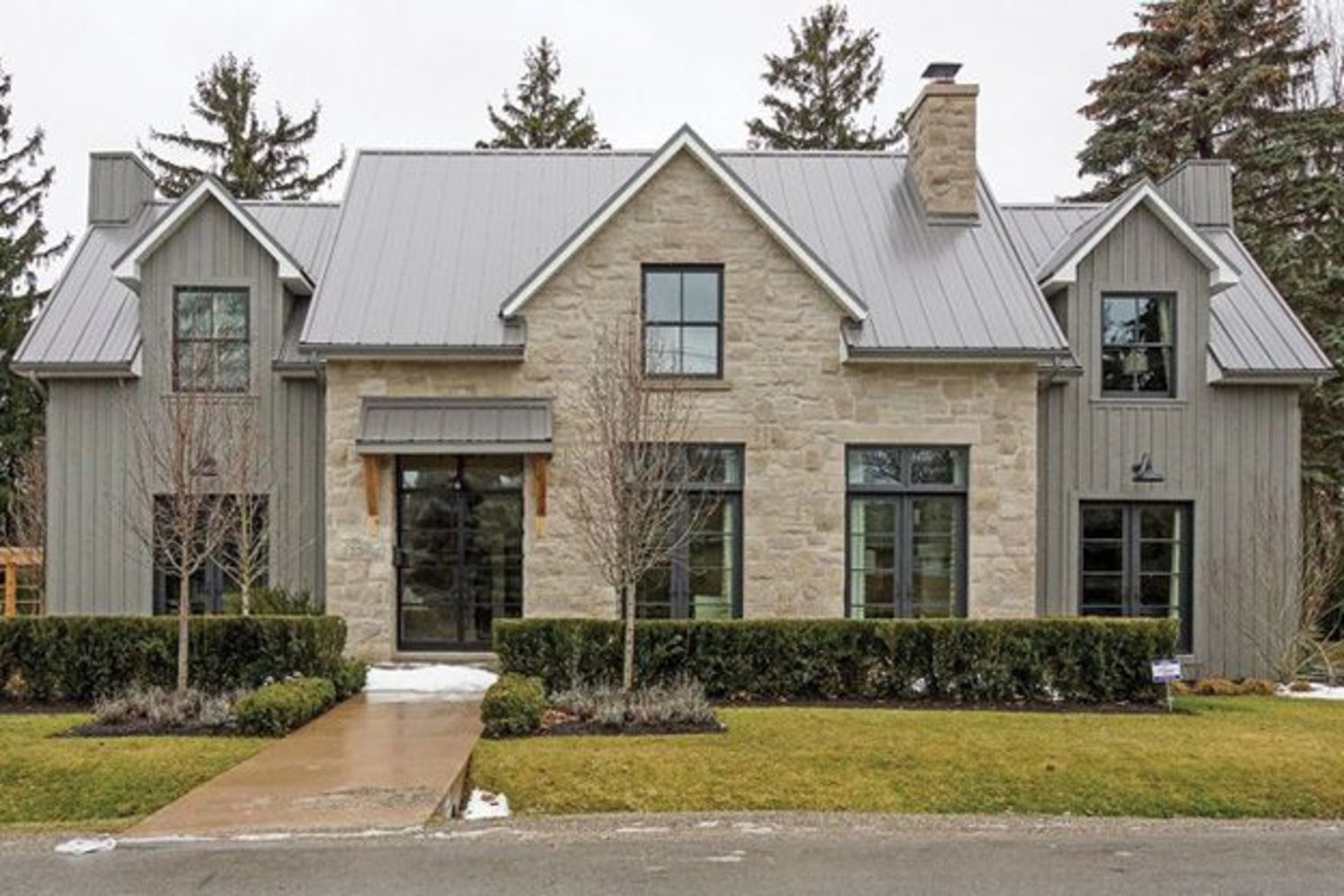 Modern house with new farmhouse exterior design pulling out country charm and warm welcoming display Image 38