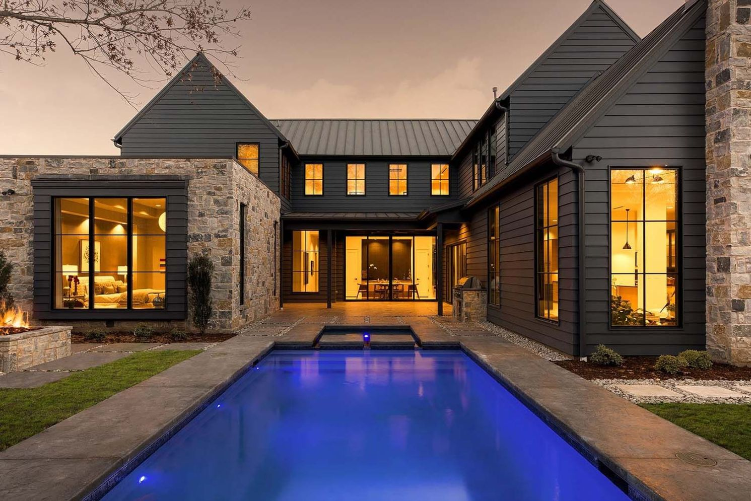 Modern house with new farmhouse exterior design pulling out country charm and warm welcoming display Image 44