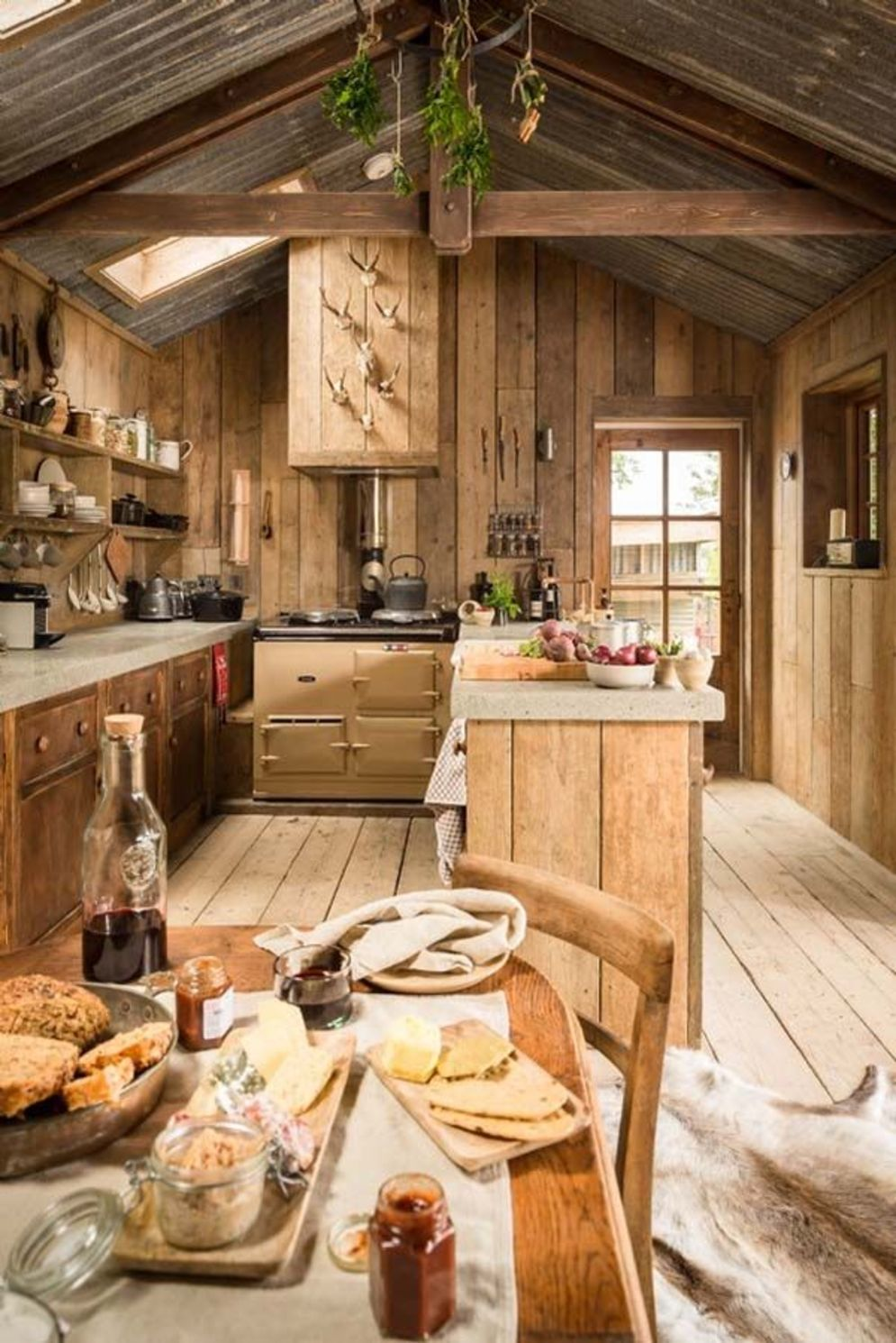 Rustic cabin kitchen designs showing warm wooden structure in earthy natural palettes Image 10
