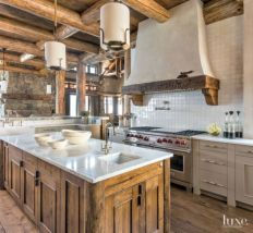 Rustic cabin kitchen designs showing warm wooden structure in earthy natural palettes Image 17