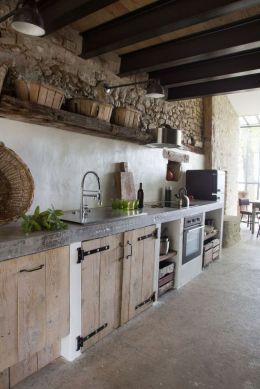 Rustic cabin kitchen designs showing warm wooden structure in earthy natural palettes Image 19