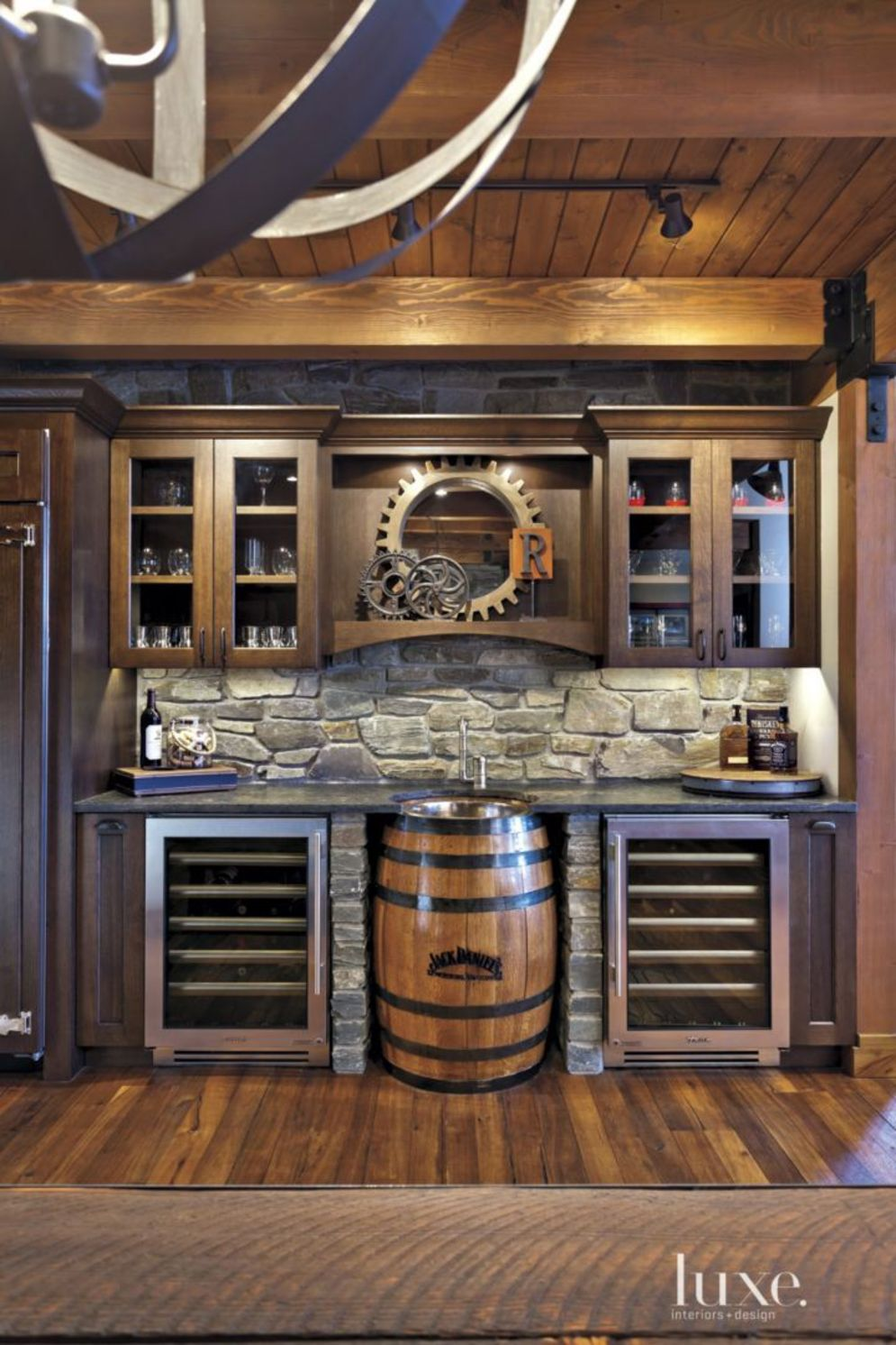 Rustic cabin kitchen designs showing warm wooden structure in earthy natural palettes Image 2