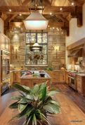 Rustic cabin kitchen designs showing warm wooden structure in earthy natural palettes Image 23