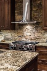 Rustic cabin kitchen designs showing warm wooden structure in earthy natural palettes Image 7