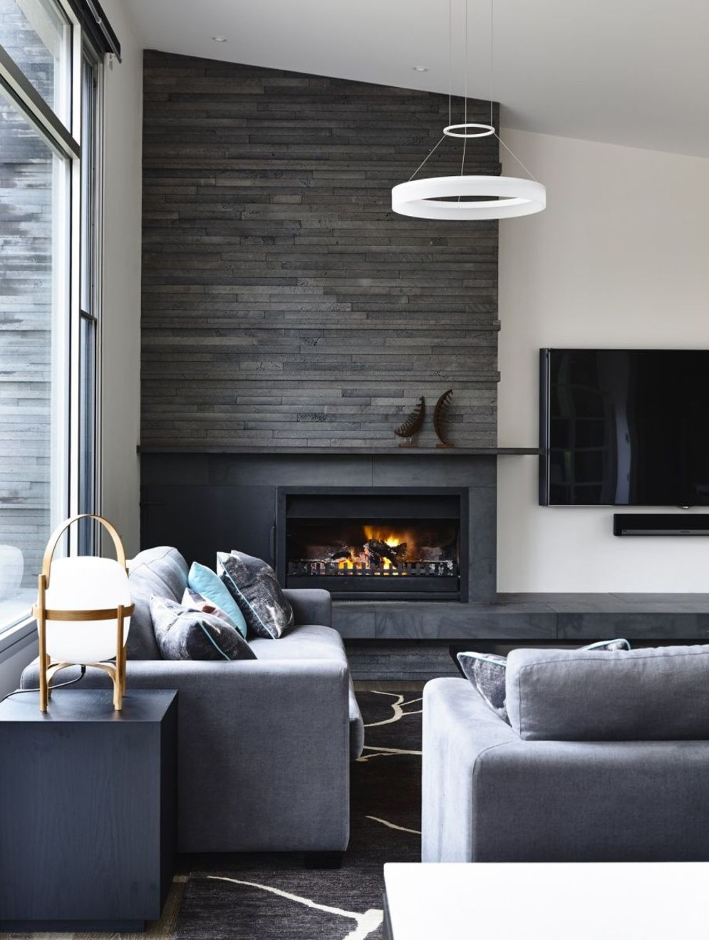 Amazing interior design showing enclosed log burning fireplace along with savvy TV wall Image 1