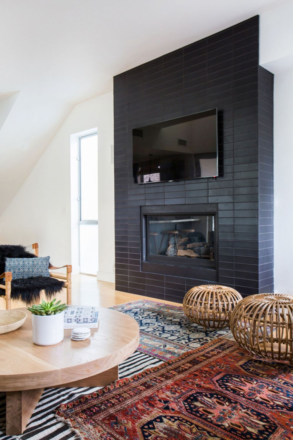 Amazing interior design showing enclosed log burning fireplace along with savvy TV wall Image 11
