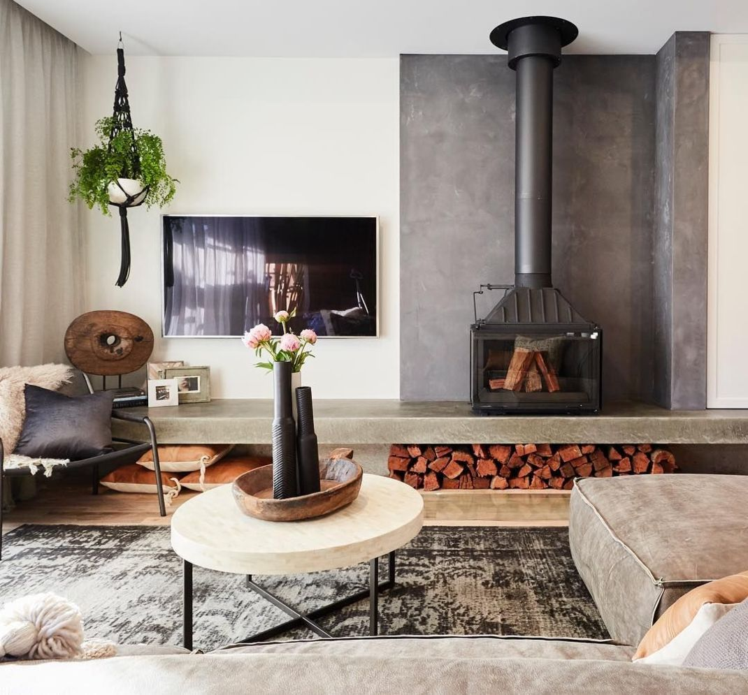 Amazing interior design showing enclosed log burning fireplace along with savvy TV wall Image 13
