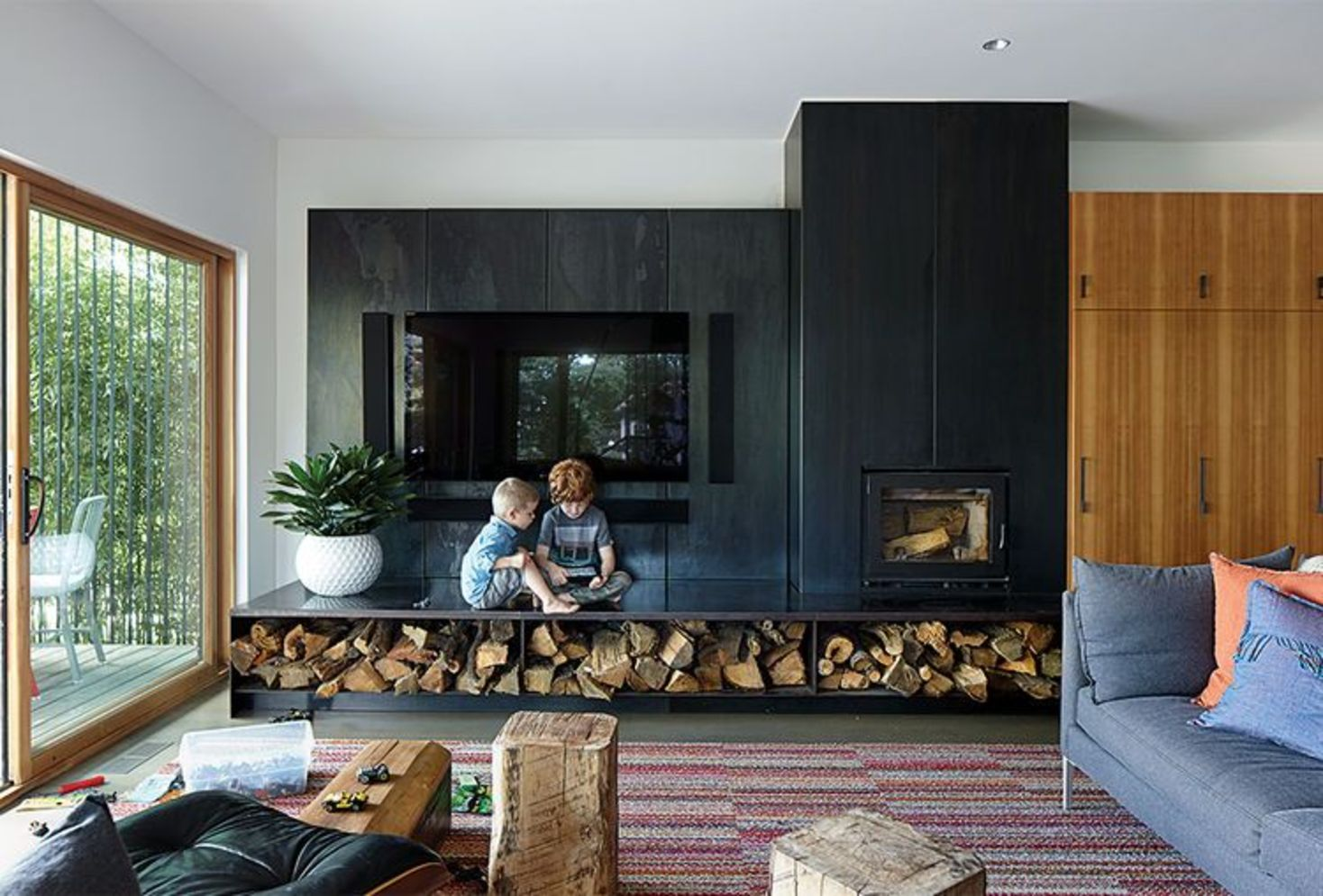 Amazing interior design showing enclosed log burning fireplace along with savvy TV wall Image 4