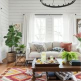 Artful interior style showcasing eclectic Bohemian display with ethnic rugs as decoration Image 1