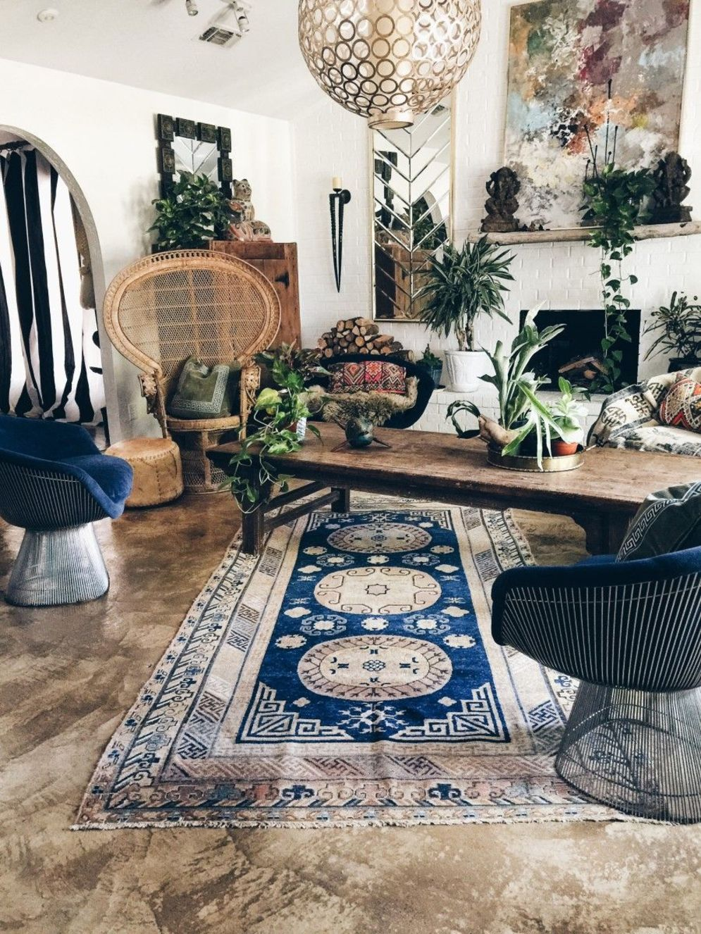 Artful interior style showcasing eclectic Bohemian display with ethnic rugs as decoration Image 13