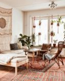 Artful interior style showcasing eclectic Bohemian display with ethnic rugs as decoration Image 20