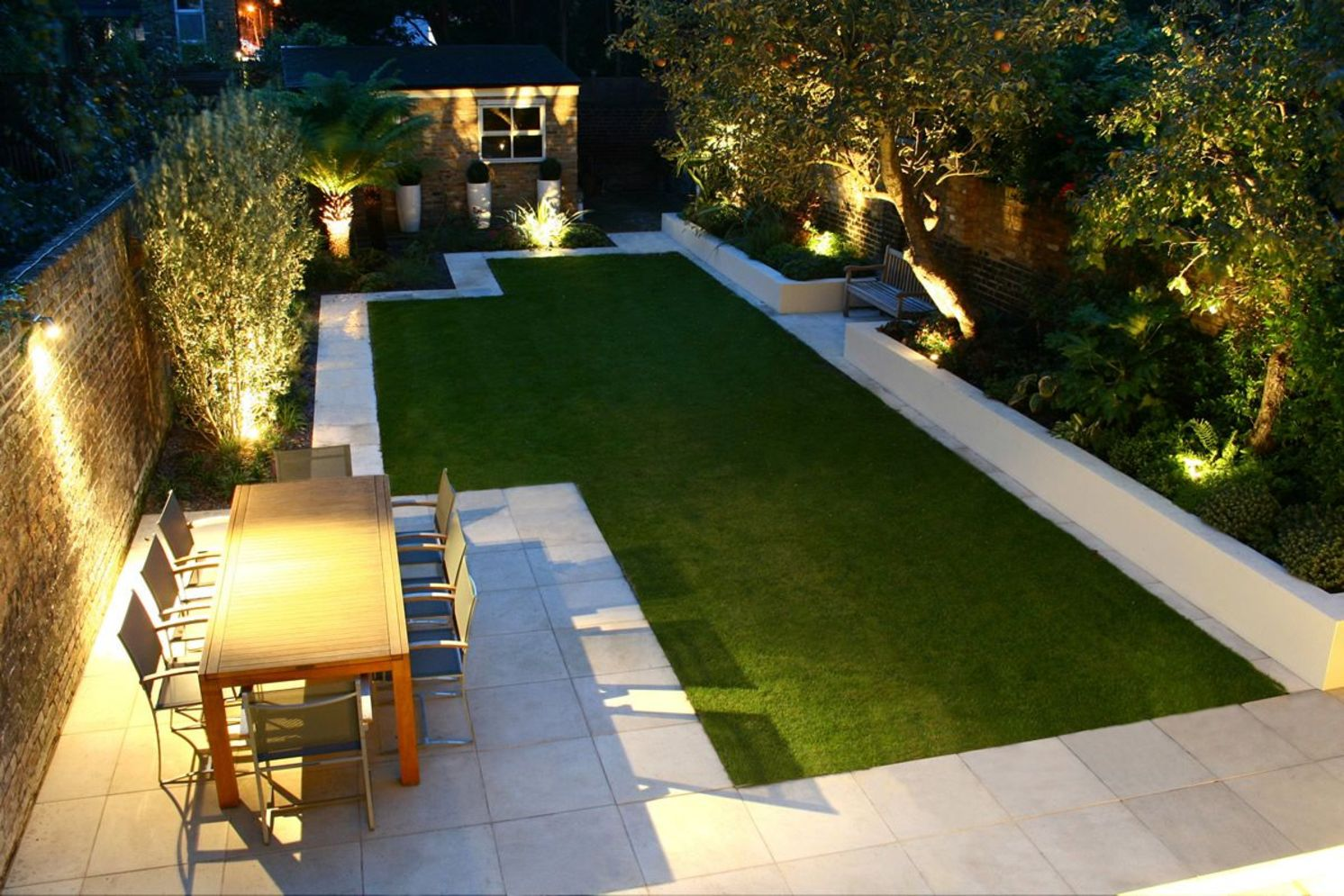 Beautiful garden lighting ideas with ground level ambient light giving luxurious resorts look Image 29