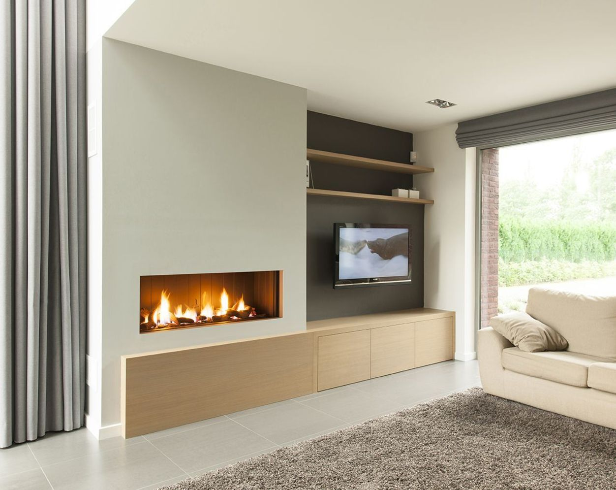 Efficient living room decoration giving exotic combination of gas burning fireplace and TV wall Image 25