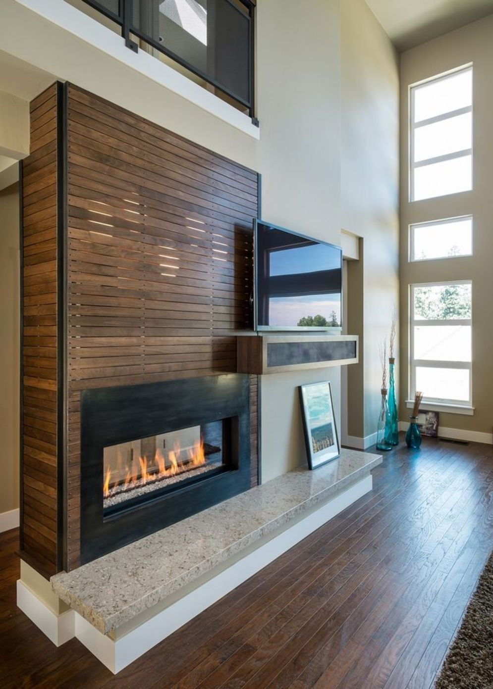 Efficient living room decoration giving exotic combination of gas burning fireplace and TV wall Image 27
