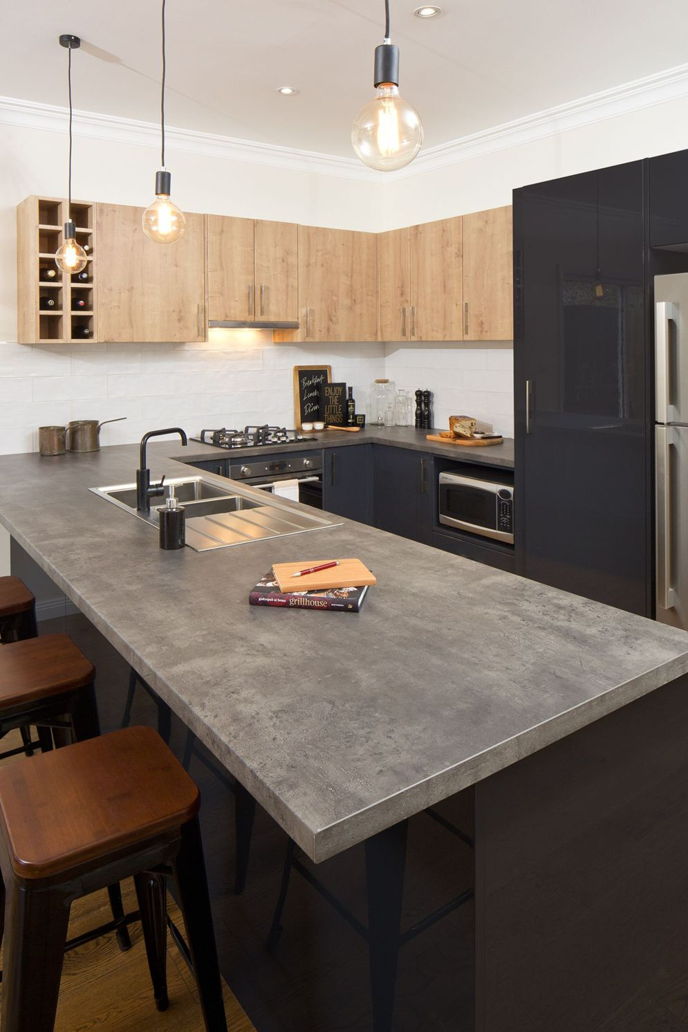 Modern kitchen updates using efficient concrete benchtops to show sturdier interior display Image 38