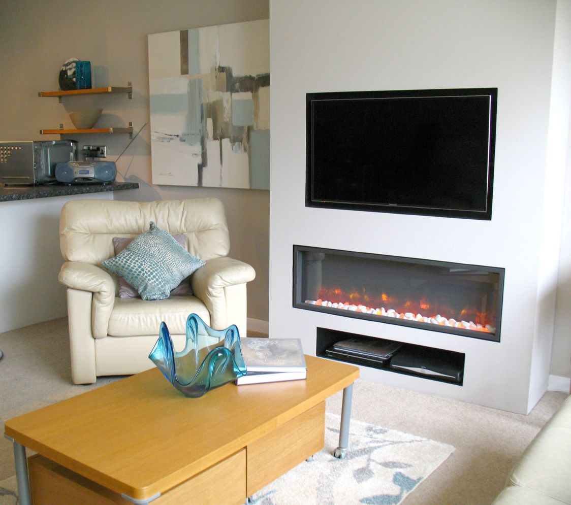 Modern living room with electric fireplace enclosed under TV wall Image 33
