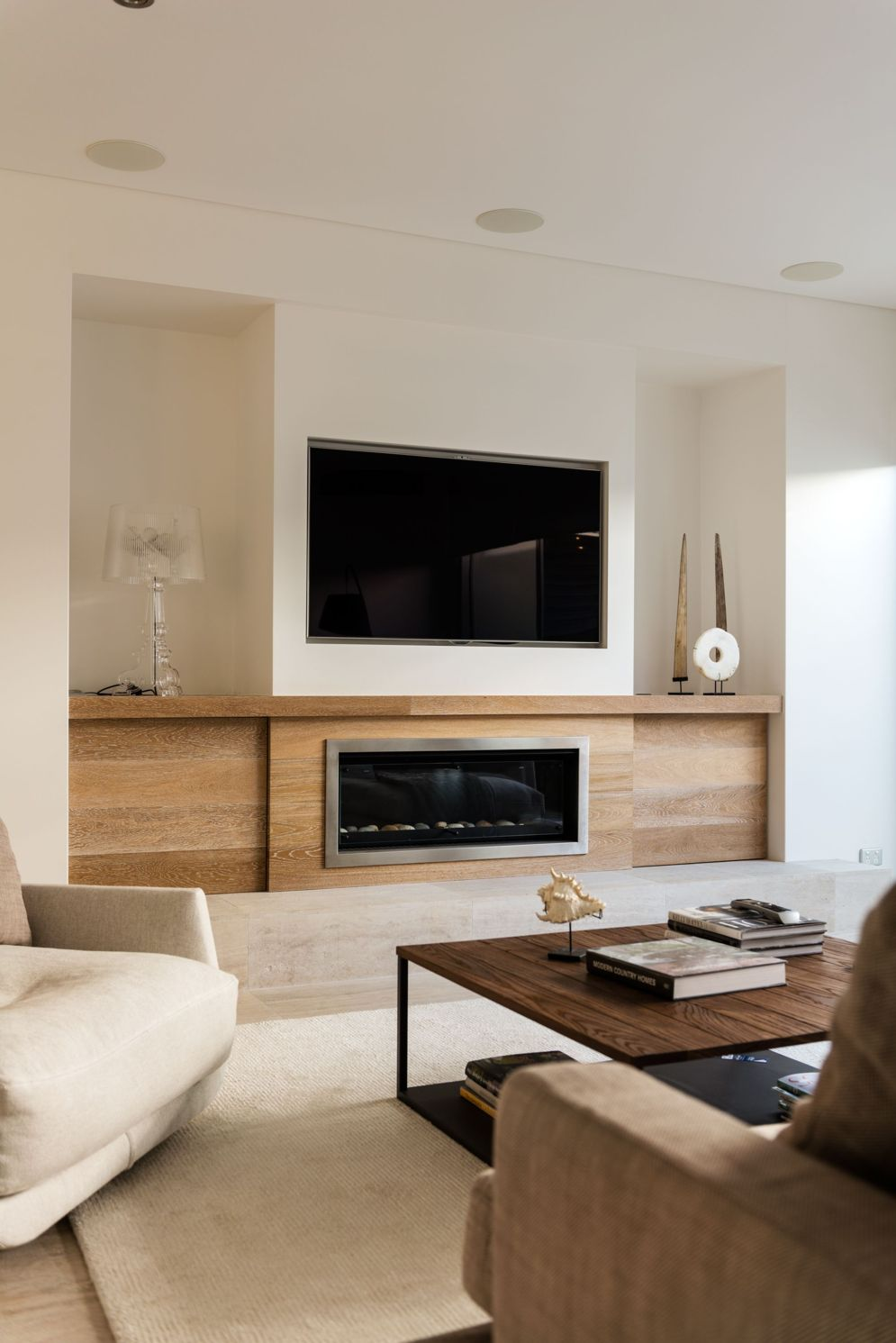 Modern living room with electric fireplace enclosed under TV wall Image 34