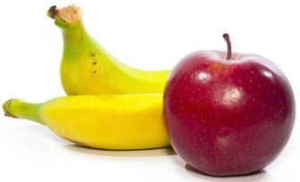 Banana and apple on white background