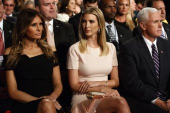 Melania Trump, left, Ivanka Trump, center, and vice presidential candidate Indiana Gov. Mike Pence wait for the beginning of the first presidential debate between Republican presidential candidate Donald Trump and Democratic presidential candidate Hillary Clinton at Hofstra University, Monday, Sept. 26, 2016, in Hempstead, N.Y. (AP Photo/ Evan Vucci)