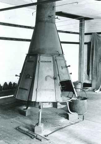 Photograph, Ironing Stove with Doors Closed, Ironing Room, Church Family, Mount Lebanon, NY, William F. Winter, Photographer, ca. 1930. Shaker Museum | Mount Lebanon 1962.14114.1.