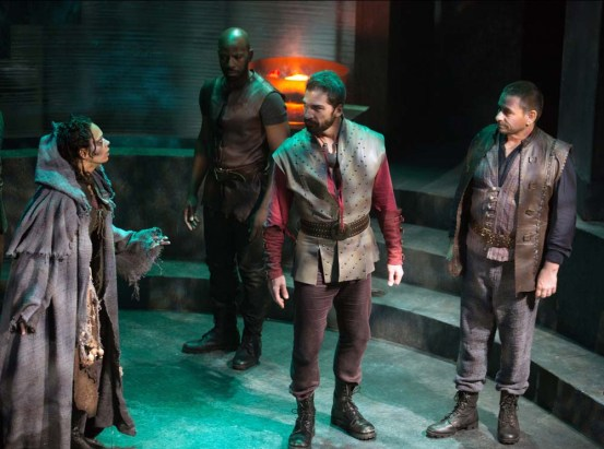 "A Soothsayer (Nafeesa Monroe, left) warns Caesar (Michael Sharon, center): ""Beware the ides of March!"" Julius Caesar, directed by Robert Richmond, Folger Theatre, 2014. Photo by Jeff Malet."