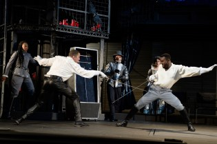 Horatio (Christiana Clark), Osric (Benjamin Bonenfant) and Gertrude (Robin Goodrin Nordli) watch as Hamlet (Danforth Comins) and Laertes (Tramell Tillman) engage in a fencing match. Photo by Dale Robinette, Oregon Shakespeare Festival.