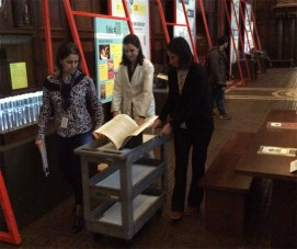 Folger conservators bring in the final First Folio to install in the exhibition.