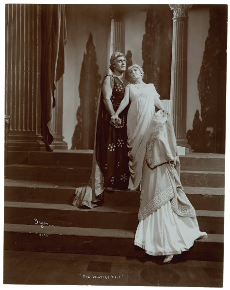 "A photograph of a 1904 production of ""The Winters Tale."" Leontes clutches the resurrected Hermione and Perdita kneels before her."