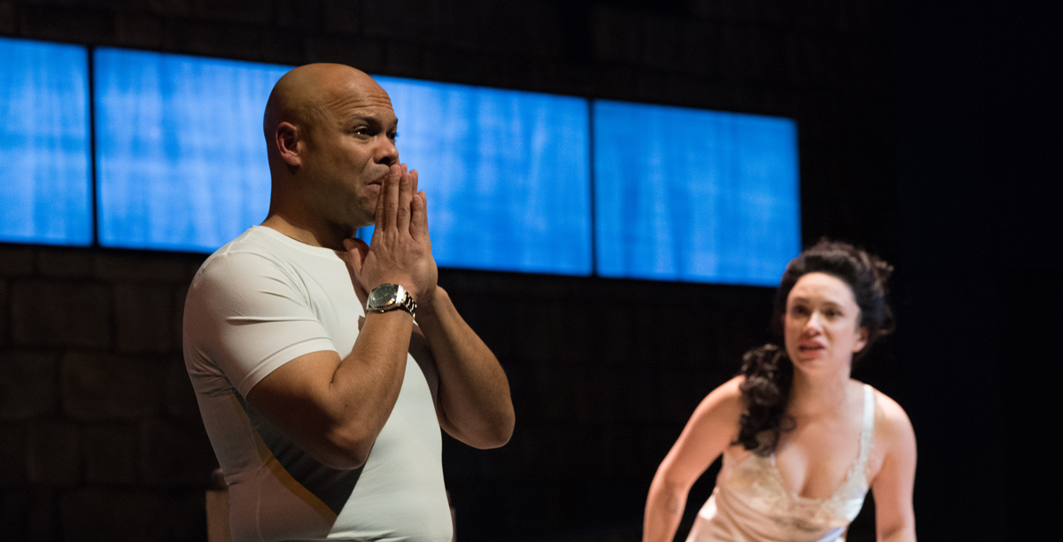 Desdemona (Alejandra Escalante) insists she's been faithful and begs Othello (Chris Butler) to spare her life.