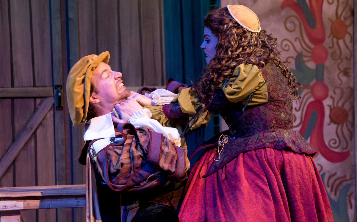 "Kate strangles Petruchio in a production of ""Kiss Me Kate"""
