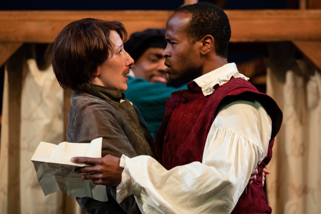 "Viola and William, characters in the Seattle Shakespeare Company's ""Shakespeare in Love,"" look at one another in surprise."