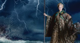 "Kate Burton as Prospera stands in front of a stormy sea in The Old Globe's ""The Tempest"""