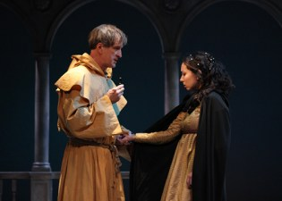 "Matt Sullivan as Friar Lawrence and Miranda Rizzolo as Juliet in ""Romeo and Juliet"" at Shakespeare Theatre of New Jersey. Photo: © Joe Guerin, The Shakespeare Theatre of New Jersey"