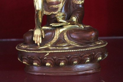 shakyamuni buddha statue lotus base and rice bowl gold