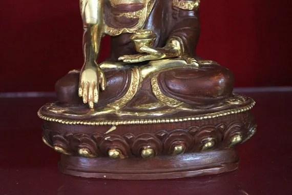 shakyamuni buddha statue lotus base and rice bowl gold