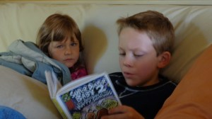 Eamon reading to Carolina