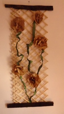 From Shalavee.com, brown paper flowers on a trellis/baby gate