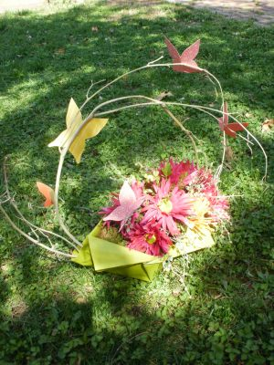 From Shalavee.com, Flower boat centerpiece with paper butterflies