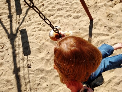 On the swing at the playground on Shalavee.com