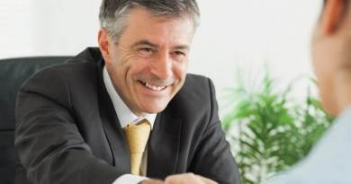 Shale Magazine: businessman shaking employee hand in a deal