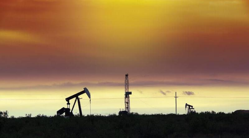 Midland TX (5/4/09) - Sunrise in the Permian Basin see pump jacks along with a new well being drilled in west Texas.