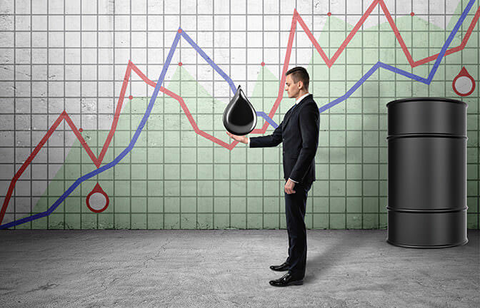 Businessman holding a drop of oil on the background of the growing graphics and a barrel of oil. Rise in oil prices. Raising rates. Stock market. Extraction of oil.