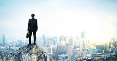 bigstock--155383196 fixed - man on cliffside overlooking cityscape with confidence
