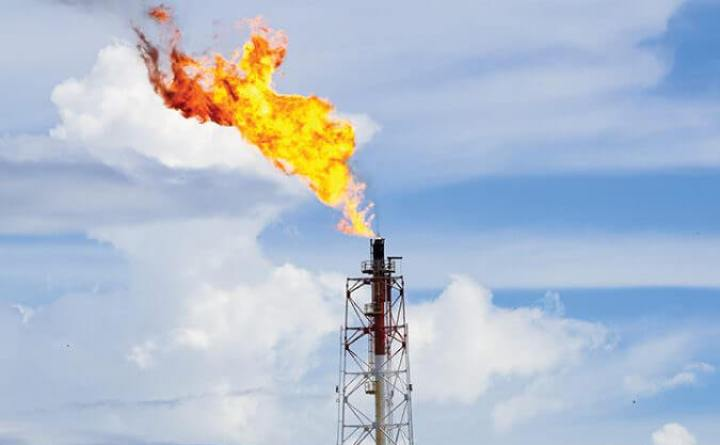 bigstock--189434089 - A gas flare at an oil refinery in the Kimanis,Sabah,Malaysia.Around 3.5% of the world's natural-gas supply was wastefully burned or flared,at oil & gas fields in 2012,according to the satellite data.